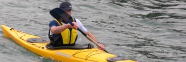 A man practicing Kayak in Lake Arenal